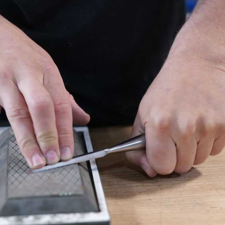 An incorrect method of flattening the chisel back
